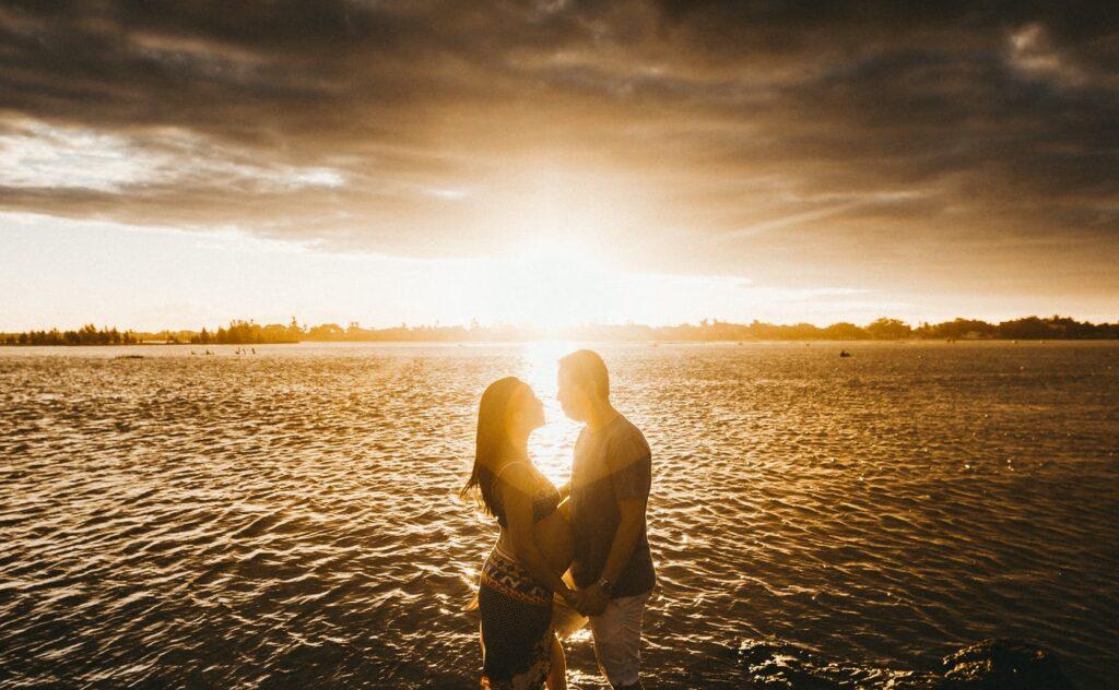 loving couple at seaside at sunset