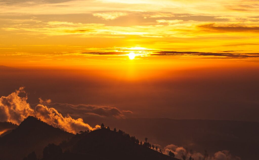 fantastic bright sunset over mountainous terrain